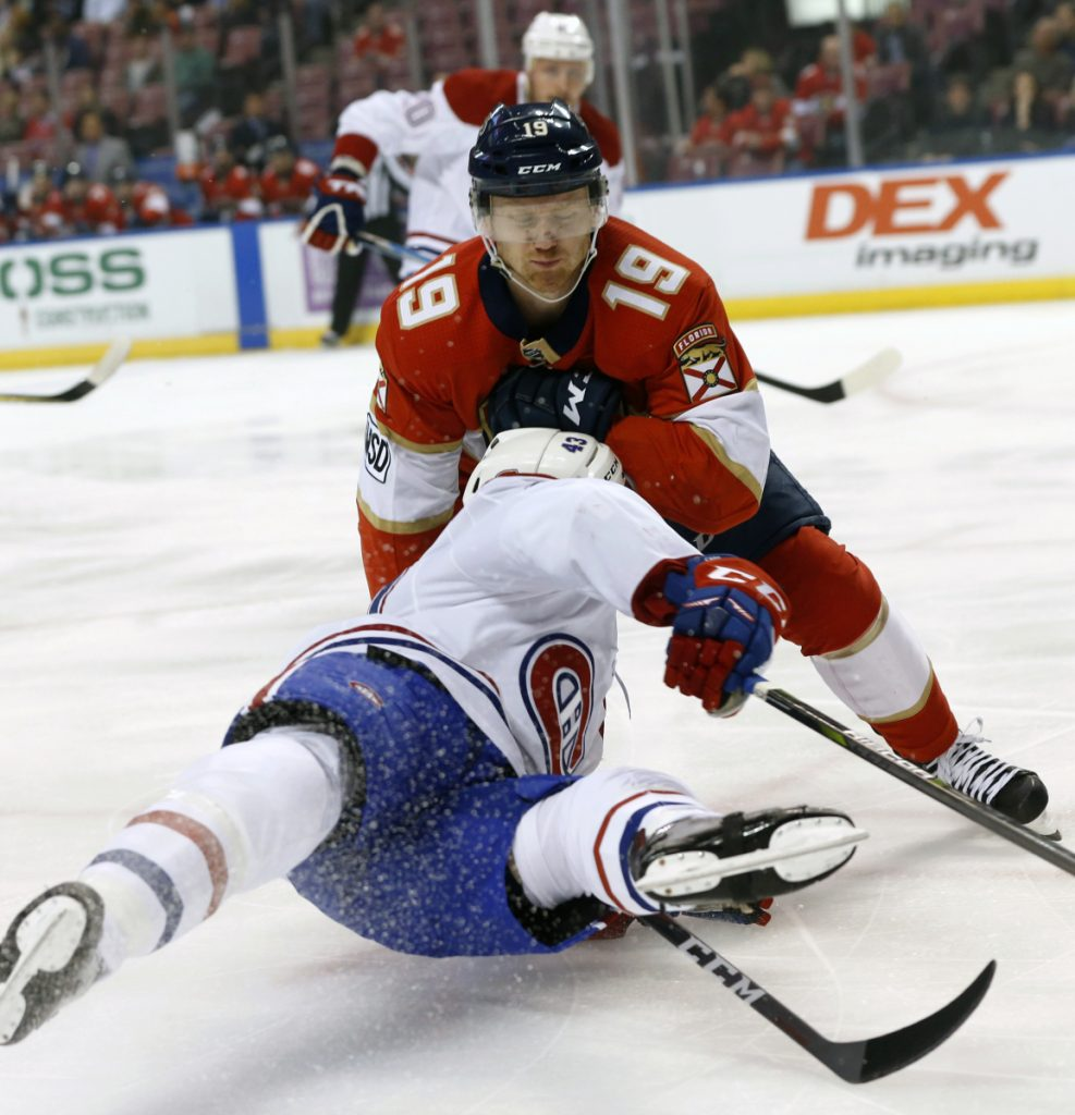Canadiens left wing Daniel Carr falls to the ice in a collision with Florida defenseman Mike Matheson during the Panthers' 5-0 win Thursday night.