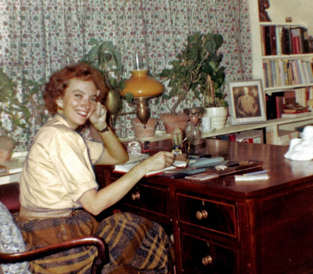Madeleine L'Engle, seen at her desk in 1959, did much of her writing at her 200-year-old farmhouse called Crosswicks in Goshen, Conn. L'Engle wrote that publishers had trouble with