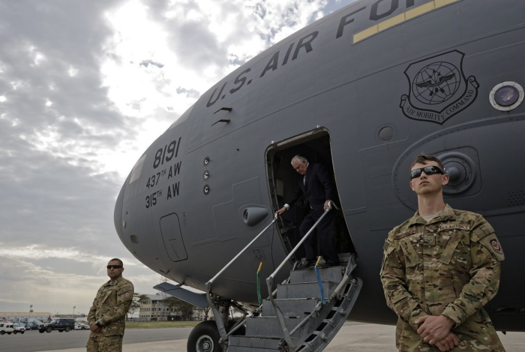 U.S. Secretary of State Rex Tillerson steps down from a U.S. Air Force plane on his arrival in Nairobi, Kenya, on Friday. On this African mission, the diplomat is visiting five nations: Chad, Djibouti, Ethiopia, Kenya and Nigeria.