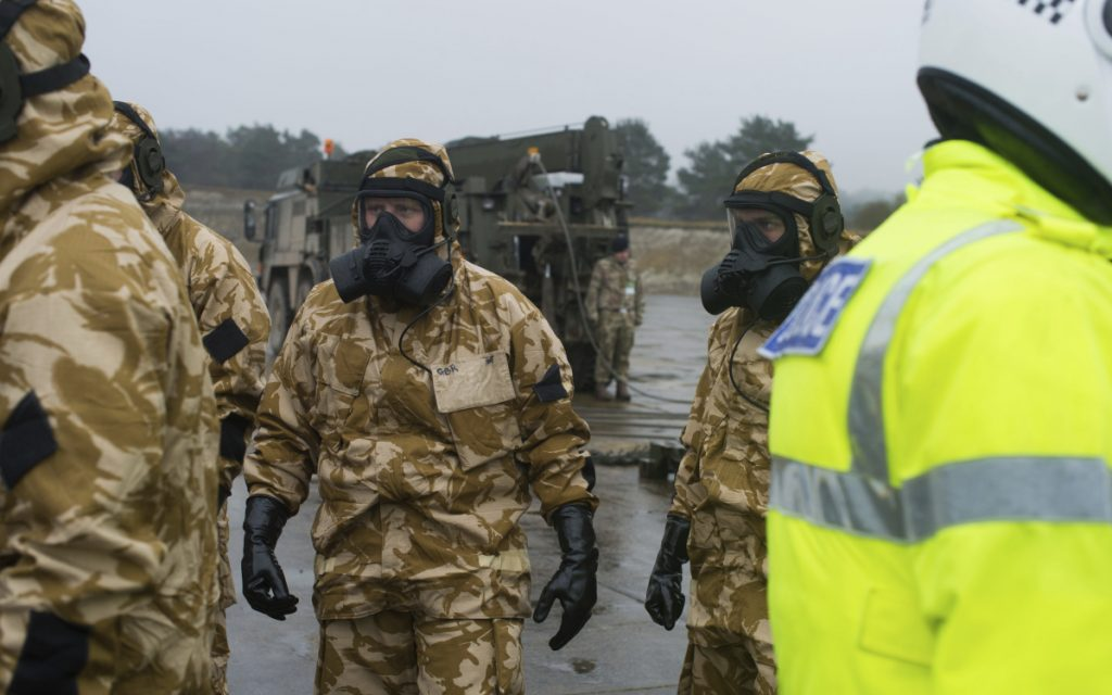 Members of the British military arrive in Salisbury, England, on Friday to help investigate the nerve-agent poisoning of a former Russian spy.