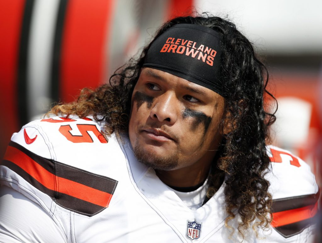 Cleveland Browns nose tackle Danny Shelton sits on the sideline during a game against the Pittsburgh Steelers in Cleveland. A person familiar with the negotiations said Saturday that the Browns have agreed to trade Shelton to the New England Patriots for a conditional draft pick.