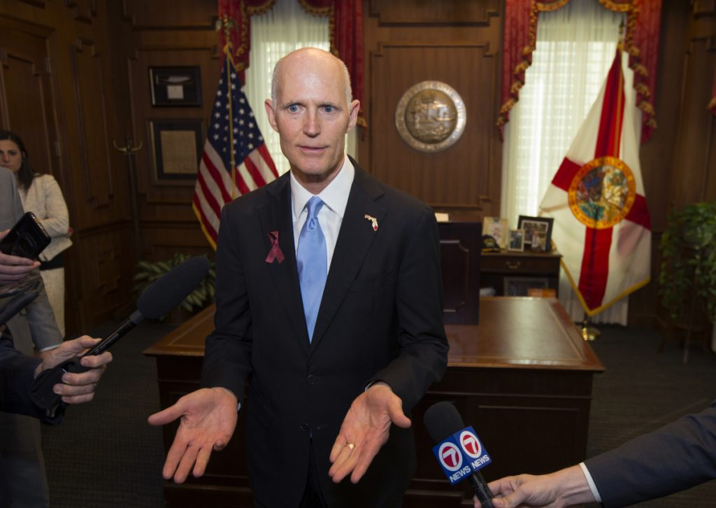 Florida Gov. Rick Scott talks about the Marjory Stoneman Douglas Public Safety Act he signed in Tallahassee on Friday. The law puts some limits on gun purchases and bans bump stocks.