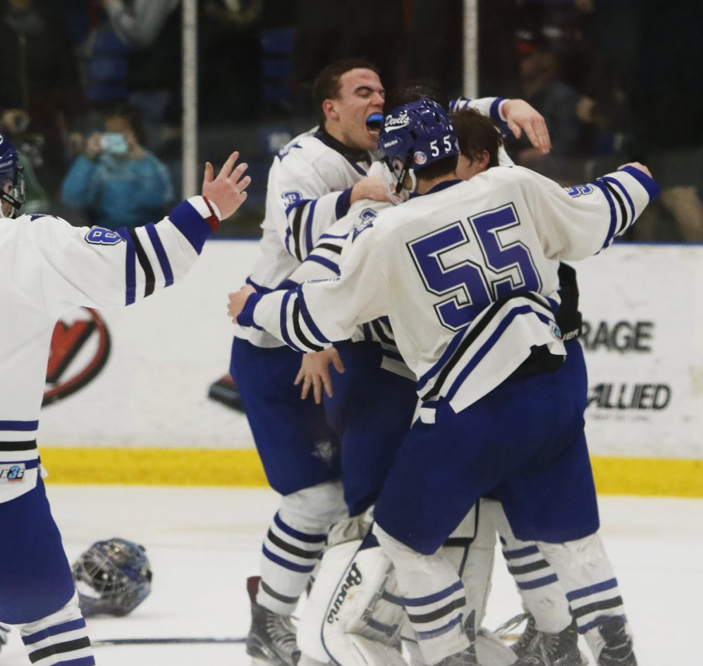 For the third year in a row, Lewiston ended its boys' hockey season with a championship celebration after beating Biddeford 2-1 in the Class A final at the Androscoggin Bank Colisee.