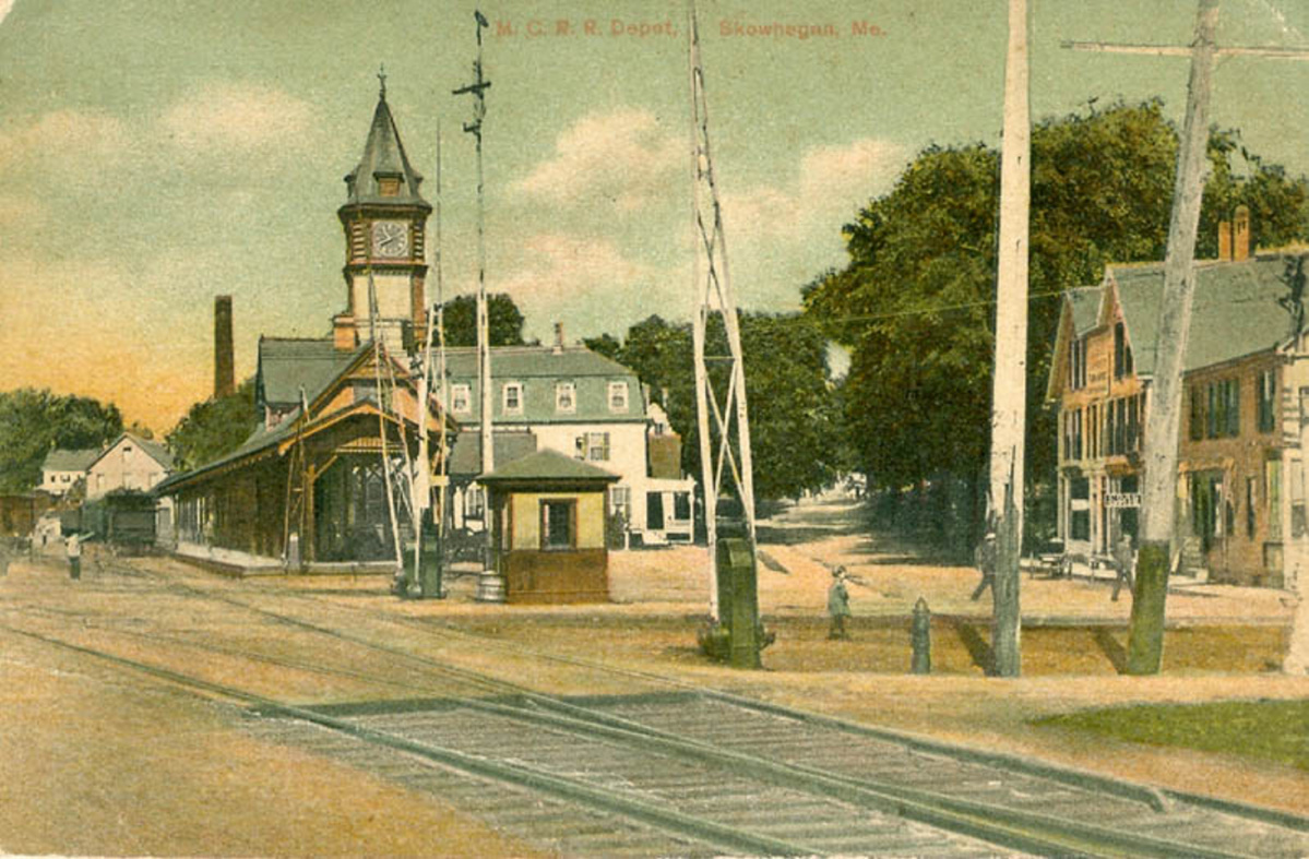 Originally The Maine Central Railroad Hotel Stands In Background Of Train Station With A Clock Tower About 1905 Downtown Skowhegan