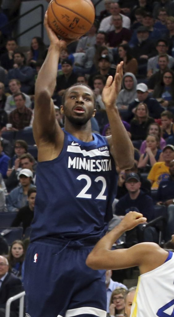 Andrew Wiggins of the Minnesota Timberwolves finds room to shoot Sunday during the 109-103 victory against the Golden State Warriors. Wiggins finished with 23 points.