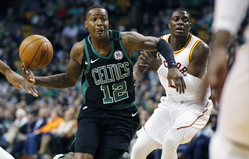 Boston's Terry Rozier drives past Indiana's Darren Collison during the first quarter of the Pacers' 99-97 win Sunday night in Boston.