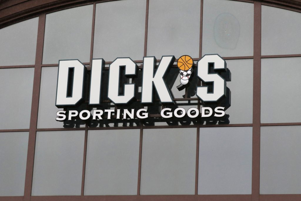 A sign for Dick's Sporting Goods store is displayed at the store in Madison, Miss. Dick's Sporting Goods stock was down early Tuesday after it reported lower-than-expected fourth quarter sales.