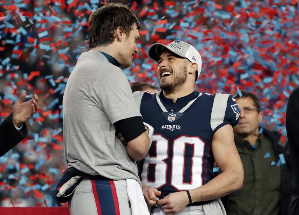 New England Patriots wide receiver Danny Amendola, right, celebrates with quarterback Tom Brad after the Patriots beat Jacksonville in the AFC championship game in January. Amendola will reportedly sign a deal to leave New England for the Miami Dolphins.