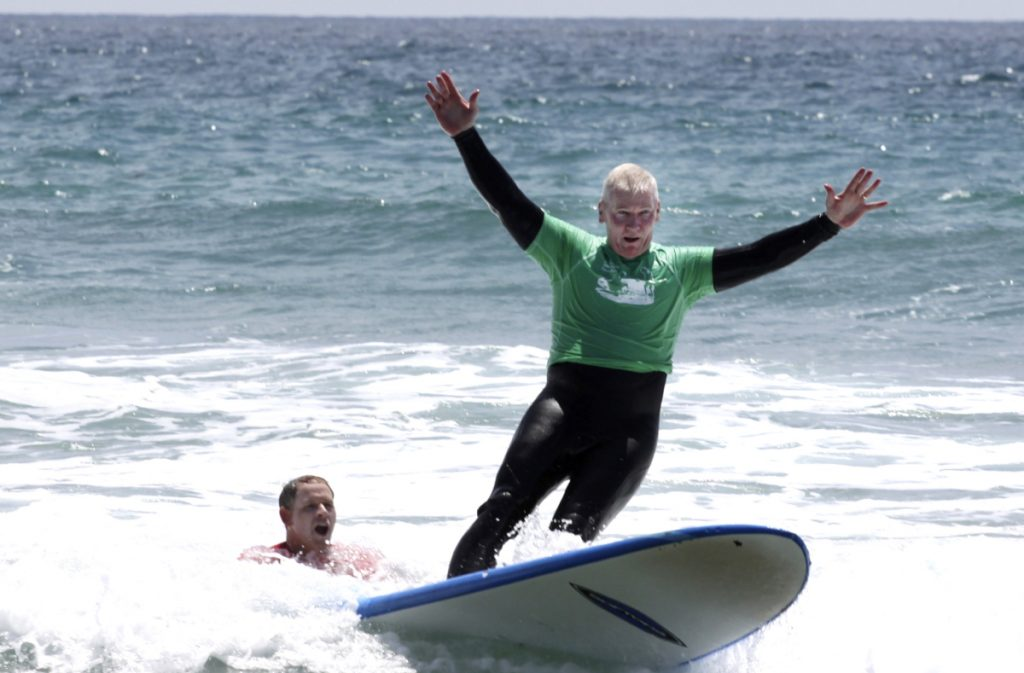 A marine surfs at Marine Corps Base Camp Pendleton in California.  The Navy has now started a $1 million research project on surfing's therapeutic benefits.