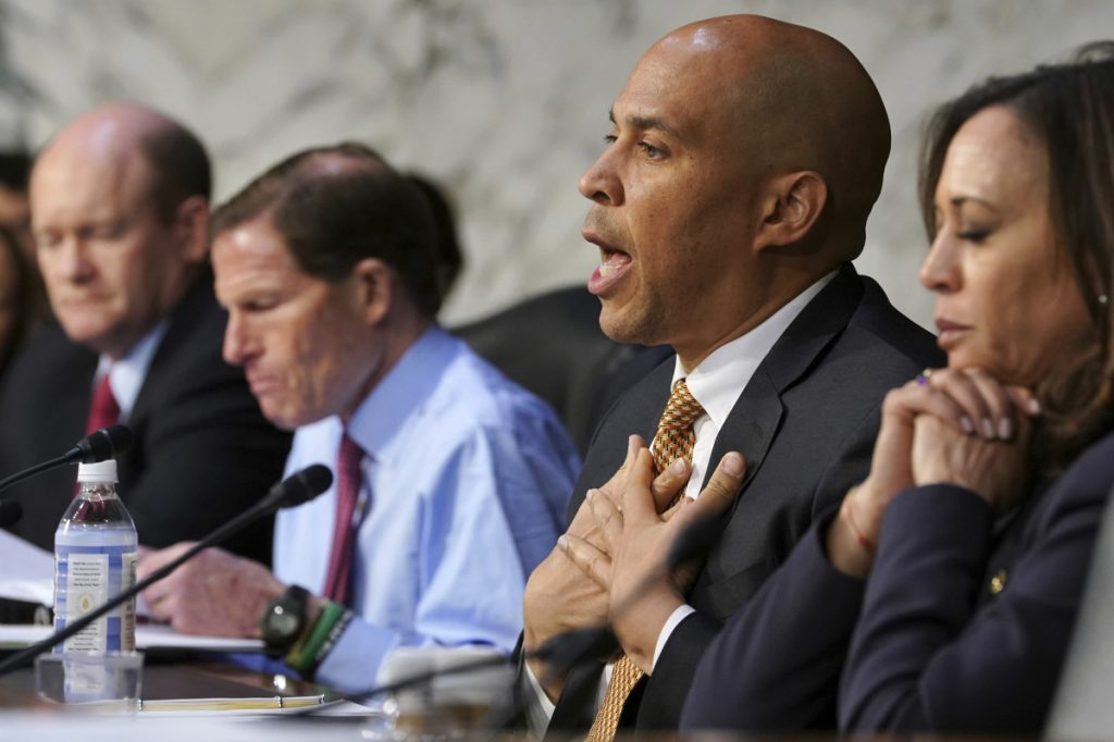 Sen. Cory Booker, D-New Jersey, talks about gun violence, during a Senate Judiciary Committee hearing on the Parkland, Florida, school shootings and school safety, on Wednesday on Capitol Hill in Washington. At left are Sen. Chris Coons, D-Delaware, and Sen. Richard Blumenthal, D-Connecticut. At far right is Sen. Kamala Harris, D-California.