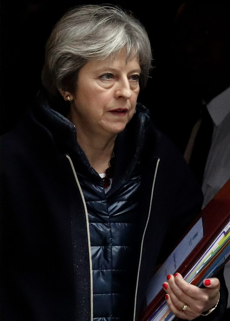 Britain's Prime Minister Theresa May leaves 10 Downing Street to attend the weekly Prime Minister's Questions session, in parliament Wednesday.
