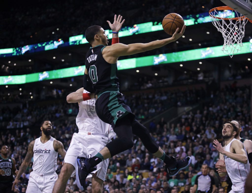 Boston forward Jayson Tatum drives to the basket against the Wizards during the first quarter Wednesday night in Boston.