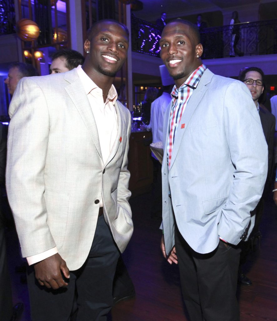 In this Jan. 31, 2013 photo, Jason McCourty, left, Devin McCourty pose at the VIP Reception hosted by the NFLPA in New Orleans.