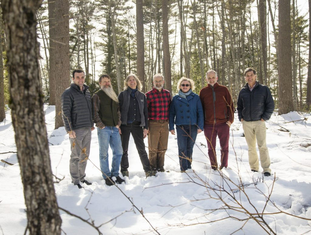 From left: Tom Abello, director of external affairs at The Nature Conservancy; Morten Moesswilde, midcoast district forester; Theresa Kerchner, executive director of Kennebec Land Trust; Harold Burnett, forester and owner of Two Trees Forestry; Nancy Smith, executive director of GrowSmart Maine; Lee Burnett, project manager at Local Wood WORKS; and Warren Whitney, land trust program director at Maine Coast Heritage Trust. Not present for the photo, which was taken at Kennebec Estuary Land Trust's Sewall Woods, a Demonstration Forest in Bath, are, Ken Laustsen, biometrician at the Maine Forest Service, Keith Bisson, president of Coastal Enterprises Inc.; Kirsten Brewer, director of membership and programs at Kennebec Land Trust; and Mike Wilson, senior program director at Northern Forest Center.