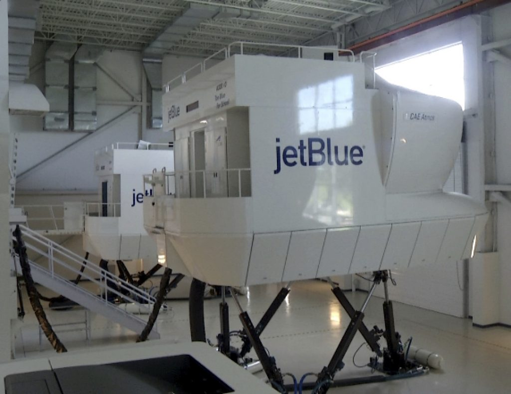 A JetBlue flight simulator in Orlando, Fla. JetBlue Airways is beginning a small-scale program of training people with no flying experience.