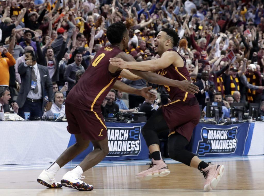 Loyola-Chicago guard Donte Ingram, left, and Marques Townes, celebrate their 64-62 win over Miami in a first-round game at the NCAA men's basketball tournament Thursday in Dallas.