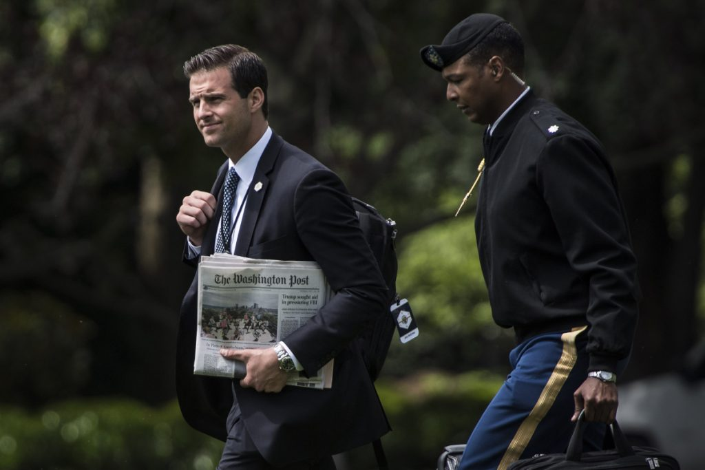 White House aide John McEntee was escorted off the White House grounds.