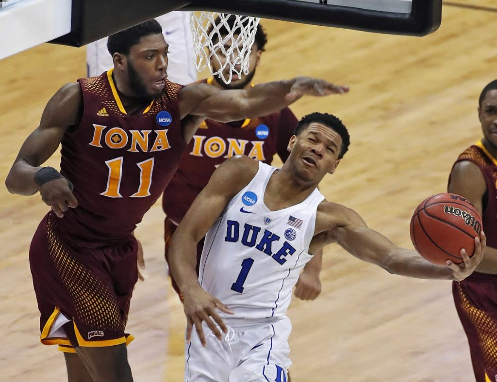 Duke's Trevon Duval gets off a shot with Iona's Roland Griffin defending during the second half of their game in Pittsburgh on Thursday. Second-seeded Duke advanced with an 89-67 victory.