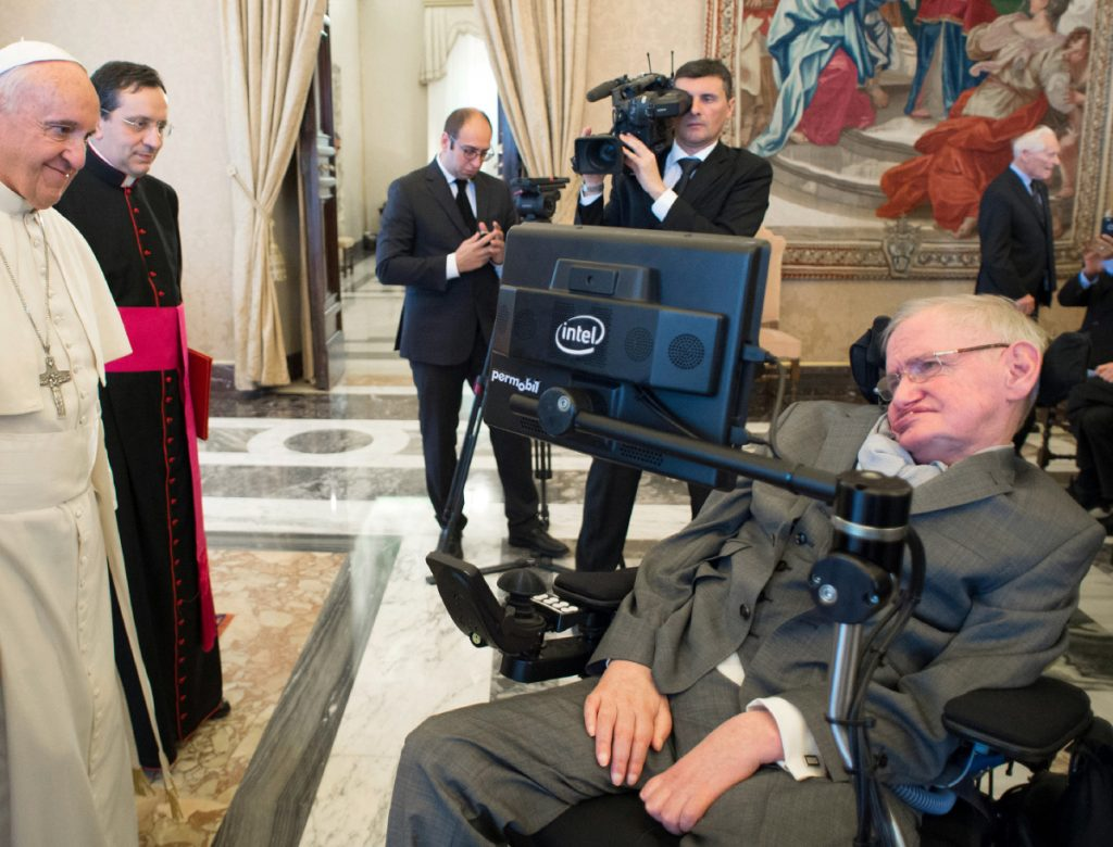 Pope Francis greets physicist Stephen Hawking during an audience with participants at a plenary session of the Pontifical Academy of Sciences at the Vatican in 2016. Hawking, whose brilliant mind ranged across time and space, died Wednesday.