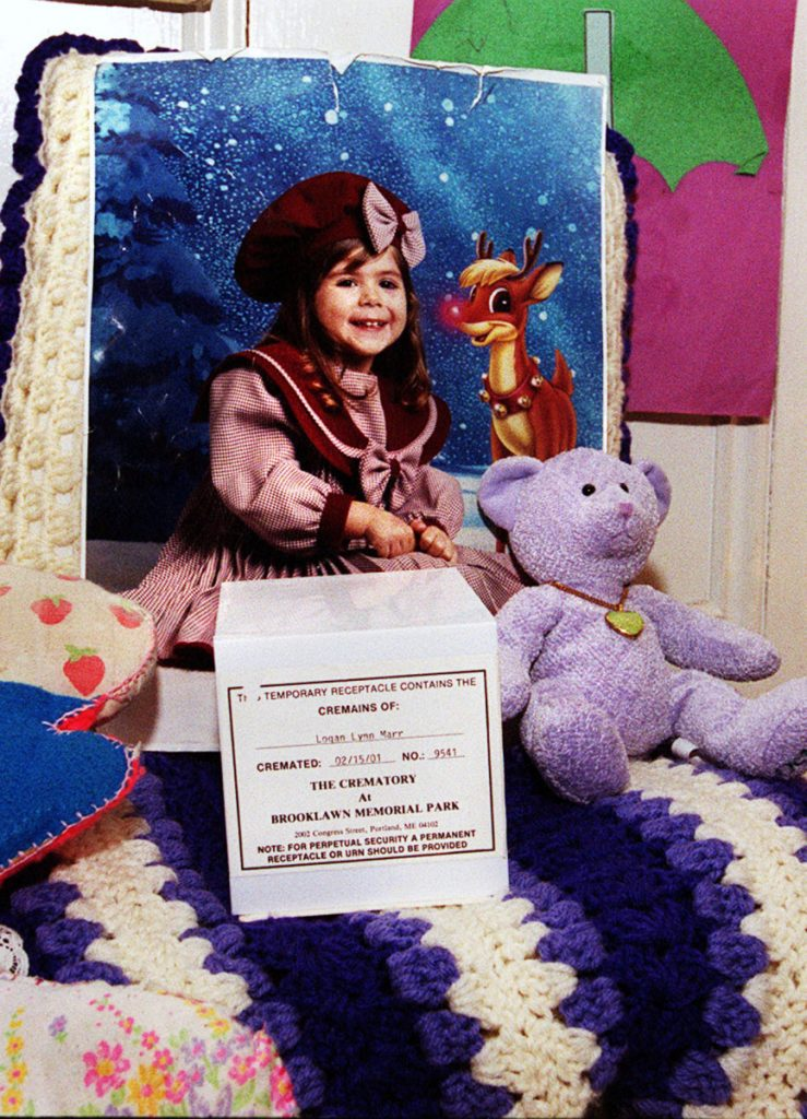 A photo of Logan Marr is part of a memorial set up at her mother's home in 2001 after the 5-year-old was suffocated to death by her foster mother. Maine has a child welfare ombudsman to whom legislators should be listening.