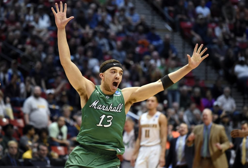 Marshall guard Jarrod West (13) reacts as time runs out in their first-round NCAA college basketball tournament game against Wichita State Friday, March 16, 2018, in San Diego. Marshall won 81-75. (AP Photo/Denis Poroy)