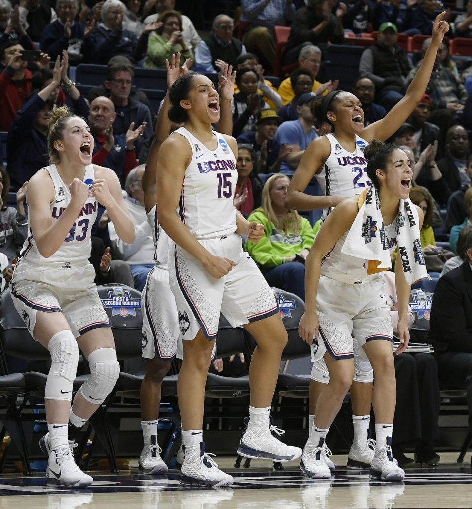 Connecticut's Katie Lou Samuelson (33), Gabby Williams (15), Kia Nurse (11), and Azurá Stevens (23) react on the sideline during the second half of a first-round game against Saint Francis (Pa.) in Storrs, Conn. on Saturday, March 17, 2018. UConn won 140-52.