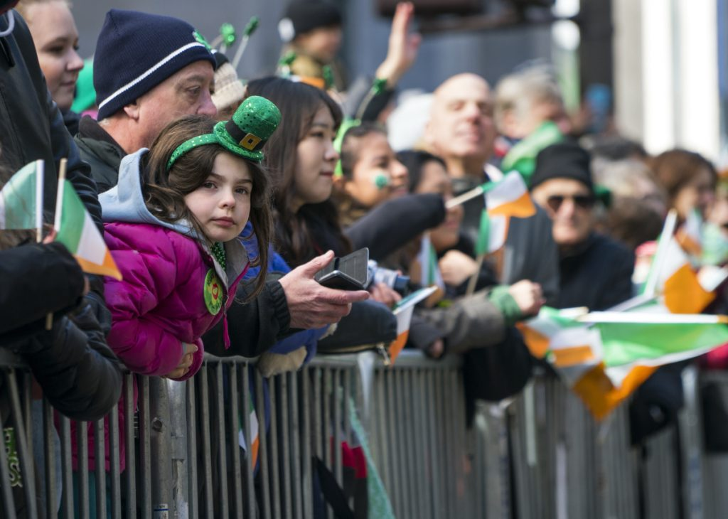Spectators watch the St. Patrick's Day Parade pass by Saturday in New York. Associated Press/Craig Ruttle