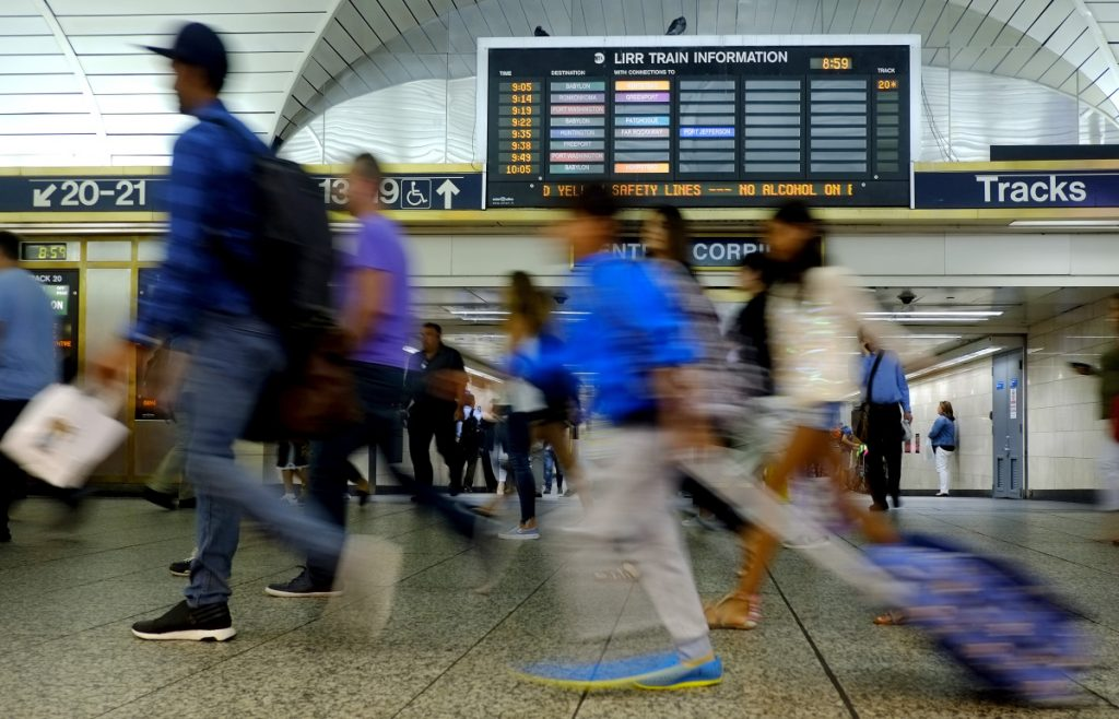Commuters rush through New York's Penn Station last year. President Trump is threatening a veto over federal funding for a long-planned upgrade to New York's commuter system.