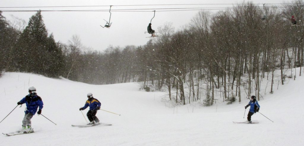 """Skiers maneuver down a slope Thursday at Mad River Glen in Fayston, Vt. Five feet of snow has fallen in Vermont this month and many areas of Maine have received more than 2 feet, """"It's the best March in years,"""" said skier Gregg Fitzgerald."""