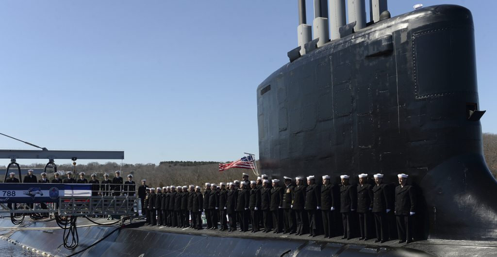 The crew of the fast-attack submarine USS Colorado man the rails Saturday during a commissioning ceremony at the Naval Submarine Base New London in Groton, Conn.