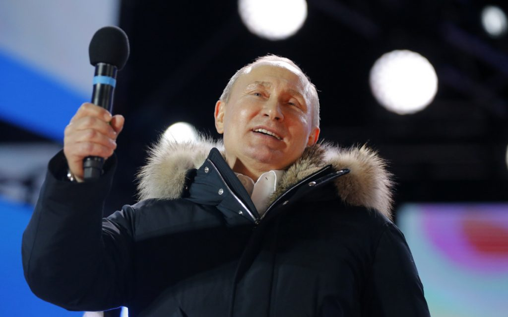 "Russian President Vladimir Putin during a rally outside the Kremlin in Moscow, Sunday. He thanked the crowd for their support in the ""very difficult circumstances"" of recent years."