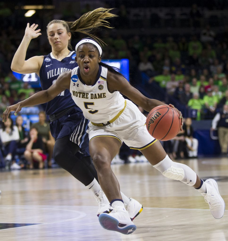 Jackie Young of Notre Dame drives by Adrianna Hahn of Villanova during their second-round game of the NCAA women's basketball tournament Sunday night. After a halftime tie, Notre Dame pulled away to a 98-72 victory.