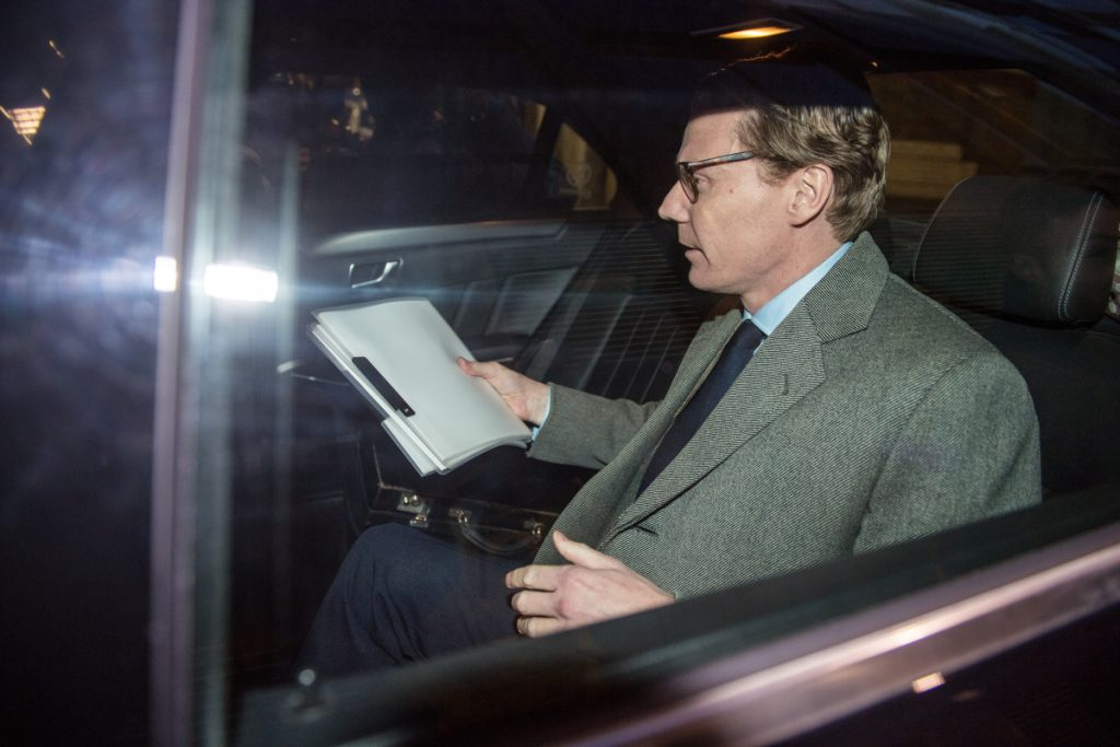 Alexander Nix, chief executive officer of Cambridge Analytica, leaves the company's offices in London on Tuesday. The company's board said it suspended Nix, effective immediately, while an independent investigation is conducted. MUST CREDIT: Bloomberg photo by Chris J. Ratcliffe