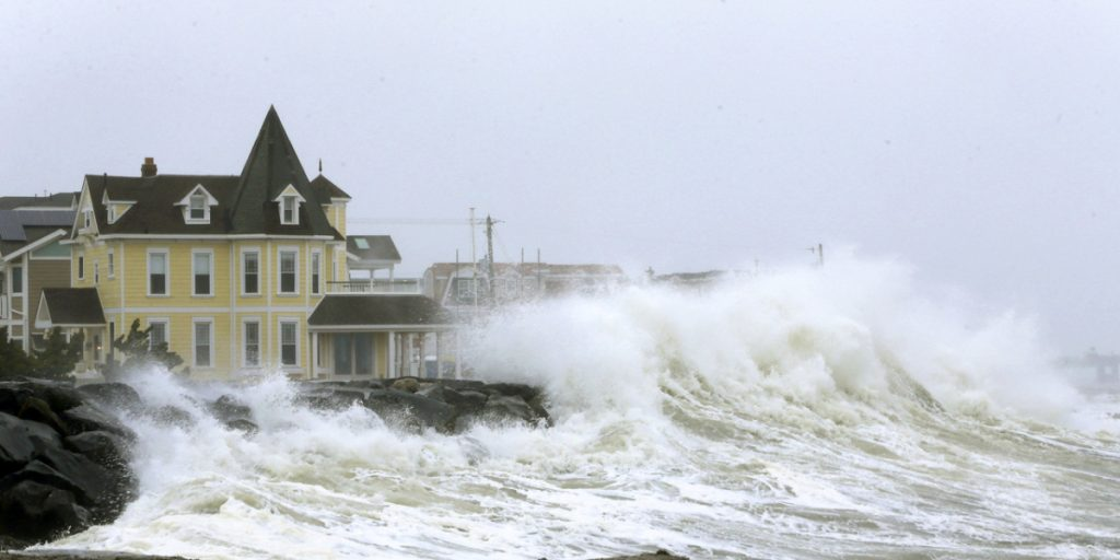 Heavy ocean surf crashes over the seawall between 7th and 8th streets in Avalon, N.J., on Wednesday. An early spring coastal storm brought wintry conditions to the southern part of the state, with high winds, coastal flooding, rain, sleet and snow.