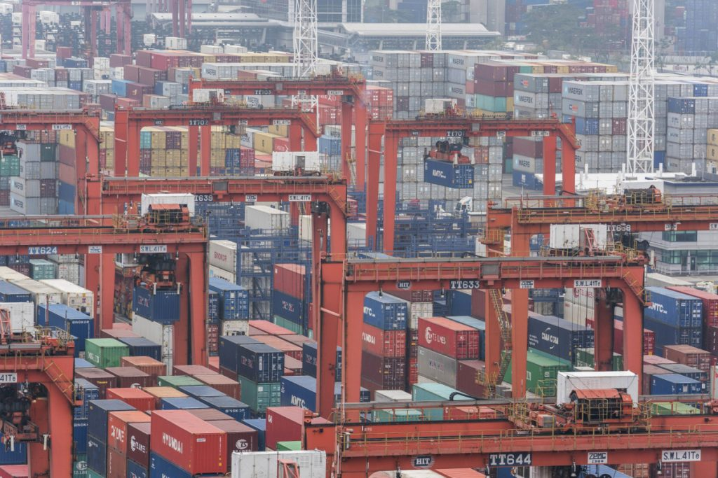 Shipping containers sit stacked among remote-controlled gantry cranes at Kwai Tsing Container Terminals in Hong Kong. The Trump administration is preparing new tariffs on Chinese imports.