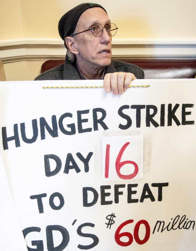 Bruce Gagnon of Bath, who opposes a multimillion-dollar tax break for Bath Iron Works, protests Feb. 27 at the State House. He ended his hunger strike Tuesday after 37 days.