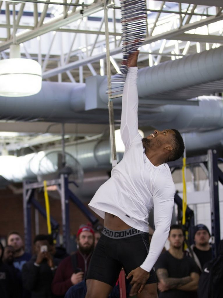 Cornerback Najee Goode, who has been training in Florida while preparing for UMaine's Pro Day, shows his talent in the vertical leap for the personnel from six NFL teams who traveled to Orono for the event Friday.
