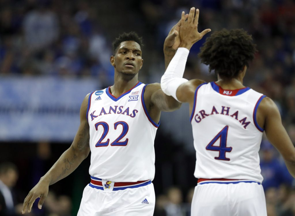 Silvio De Sousa celebrates with Kansas teammate Devonte Graham during an 80-76 victory Friday night against Clemson in Omaha Nebraska. The top-seeded Jayhawks will play Sunday for a spot in the Final Four