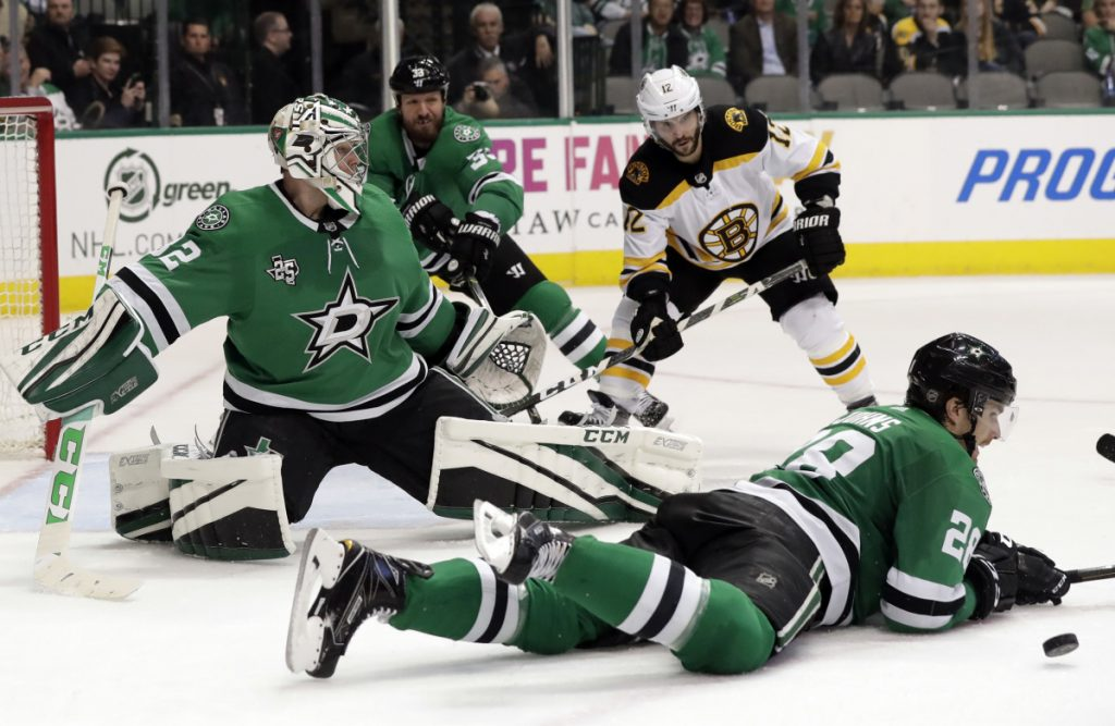 Dallas Stars defenseman Stephen Johns lays down to block a shot as goalie Kari Lehtonen, defenseman Marc Methot (33) and Boston's Brian Gionta (12) watch in the second period of the Bruins' 3-2 win Friday in Dallas.