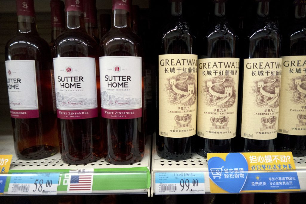 Wine from the United States is displayed next to Chinese wine at a supermarket in Beijing. China announced a $3 billion list of U.S. goods including pork, apples and steel pipe on Friday that it said may be hit with higher tariffs in a spiraling trade dispute with President Donald Trump that companies and investors worry could depress global commerce.