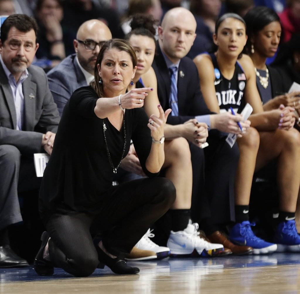 Duke Coach Joanne P. McCallie saw her team's season come to an end Saturday against top-ranked Connecticut, which moved a step closer to an 11th straight Final Four by defeating the Blue Devils 72-59 in a regional semifinal in Albany, N.Y.