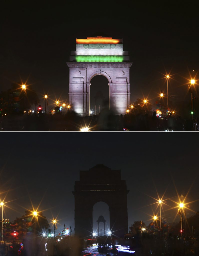 The landmark India Gate monument is shown lighted, top, and then in darkness when the lights were turned out for one hour to mark Earth Hour, in New Delhi, India, Saturday.