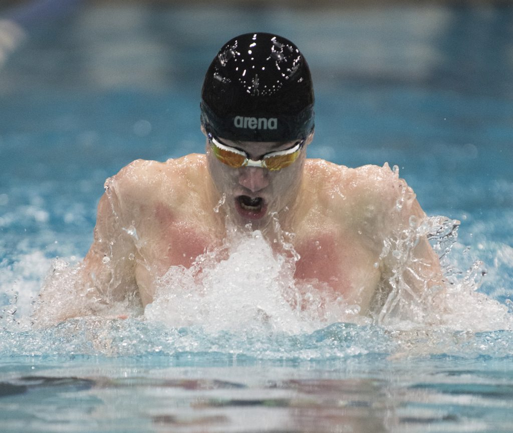 Colby Prouty of Bangor lowered his own state record in the 100 breaststroke to 56.17 seconds at the Class A meet last month. winning the event for a fourth straight year. He also took a third straight title in the 200 IM and is the male Swimmer of the Year.