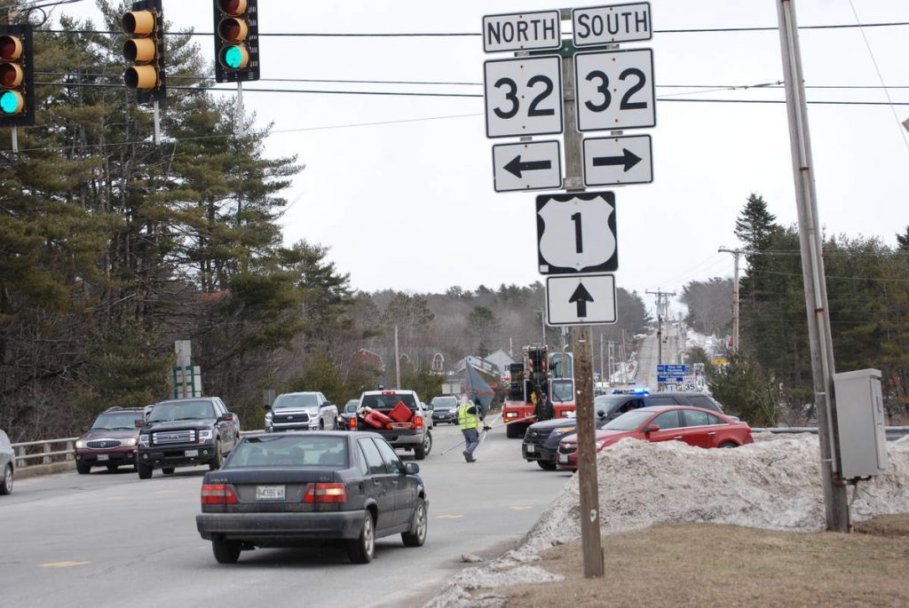 The intersection of Route 1 and Route 32 in Waldoboro begins to be cleared after the removal of a vehicle that was discovered upside down in the Medomak River early Sunday. The single occupant died in the crash.