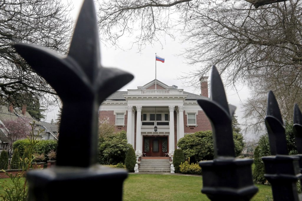 A metal fence surrounds the residence of Russia's consul general in Seattle. The United States on Monday kicked out Russian diplomats and ordered Russia's consulate in Seattle to close, as the West sought joint punishment for Moscow's alleged role in poisoning an ex-spy in Britain.
