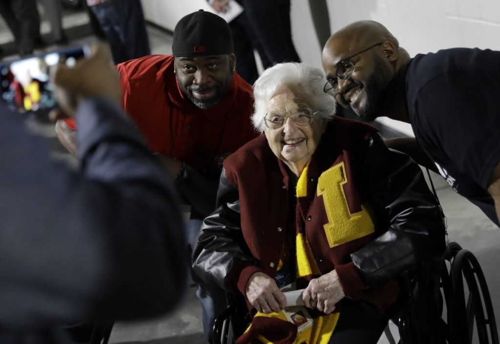 Loyola-Chicago basketball chaplain Sister Jean Dolores Schmidt, poses with fans for a photo before the first half of the NCAA regional final in Atlanta on Saturday. (AP Photo/David Goldman)