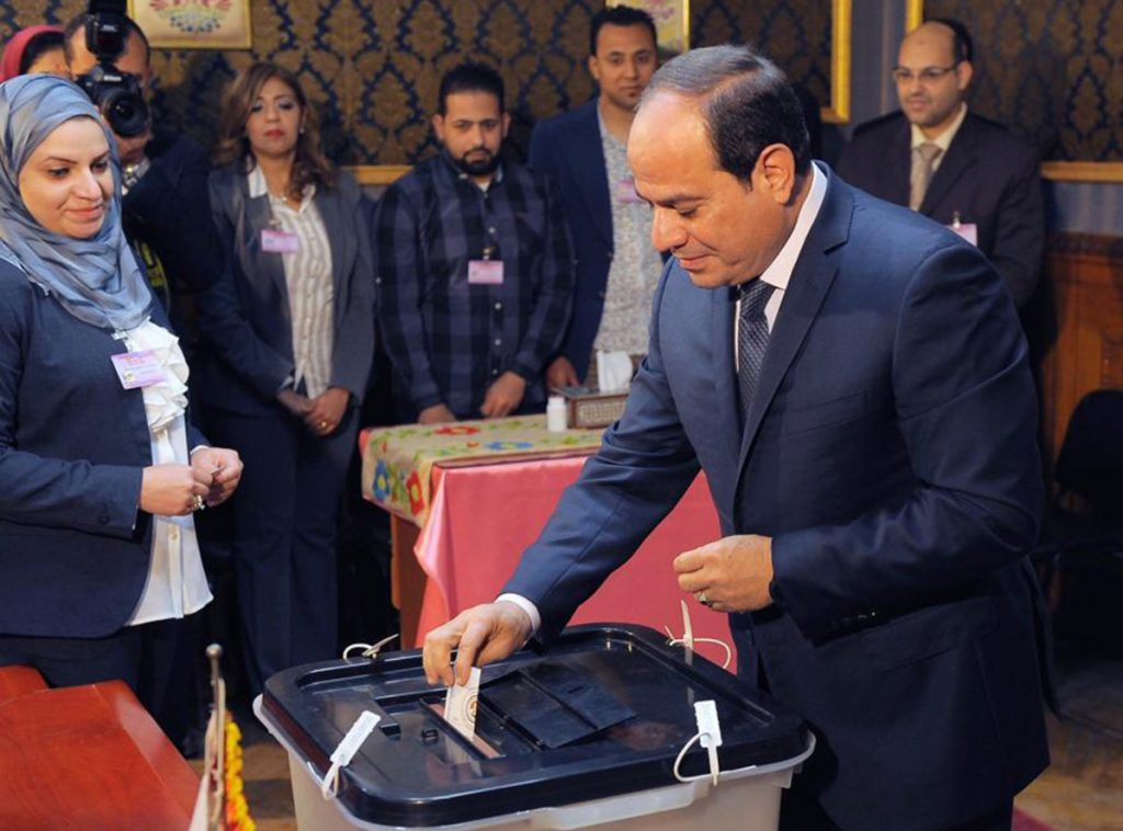 Egyptian President Abdel-Fattah el-Sissi votes in Cairo, Egypt, where he is running largely unopposed. Voting is being pushed as a patriotic duty.