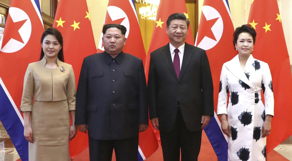 Chinese President Xi Jinping, second from right, and his wife, Peng Liyuan, right, hosted North Korean leader Kim Jong Un, second from left, and his wife, Ri Sol Ju, at the Great Hall of the People in Beijing.