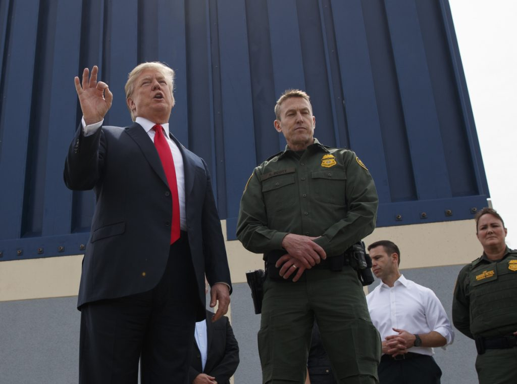 President Trump reviews a border wall prototype in San Diego earlier this month. He suggested that the military could fund the long-promised wall in a tweet.