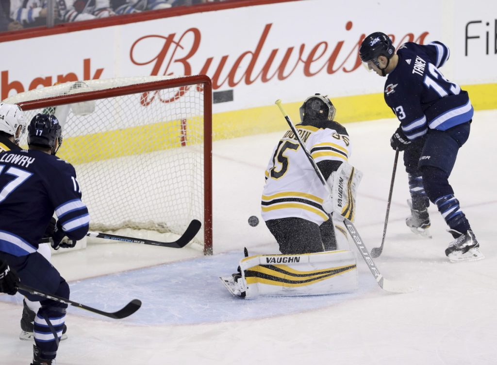 Boston goaltender Anton Khudobin gives up a goal to Winnipeg's Brandon Tanev in the first period of Tuesday's game. Tanev scored three goals.